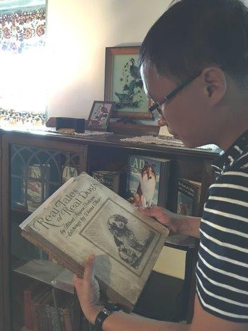 Mr. Vu Danh Tuan  reviewed the Terhune Collection of books and artifacts at Van Riper-Hopper House Museum in Wayne.